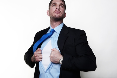 apart: handsome businessman pulling his shirt apart doing a superhero businessman poses