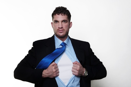 handsome businessman pulling his shirt apart doing a superhero businessman poses photo