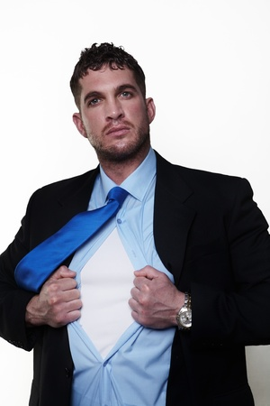 handsome businessman pulling his shirt apart doing a superhero businessman poses Stock Photo - 13916953