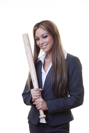 woman holding a baseball bat as if she is about to hit someone or some thing photo