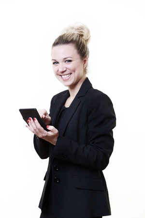 sums: business stlye image of woman standing working our sums on a calculator Stock Photo
