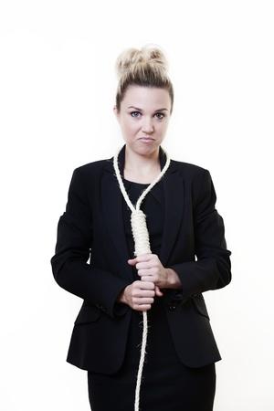choke: unhappy businesswoman whos put a hangman noose around her neck