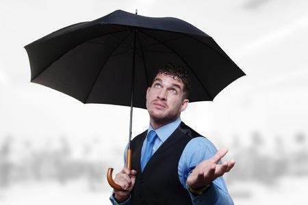 businessman standing under a umbrella  photo