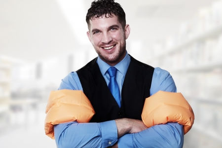 arm bands: handsome business type man wearing rubber arm bands looking at the camera looking silly