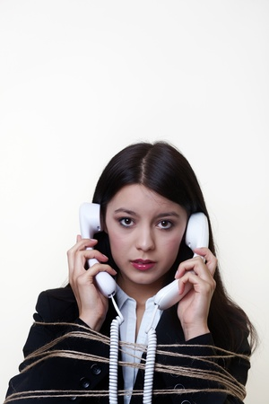 business woman on the phone with string around her  photo