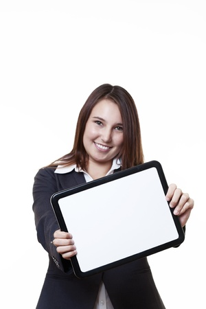 very young looking woman in a suit holding out a blank white board Stock Photo - 14431450