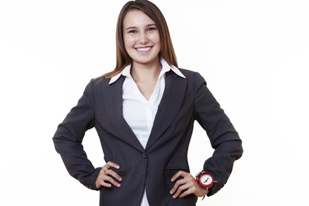 girl with a wristwatch: very young happy looking woman in a business suit wearing a traditional alarm clock on her wrist