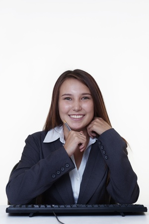 very young looking happy business woman with a big smile Stock Photo - 14431760