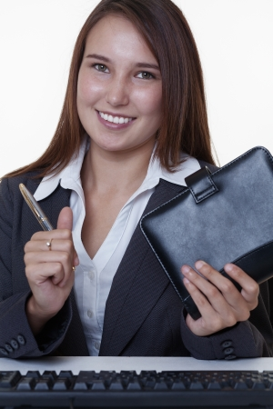 very young looking happy business woman with a big smile Stock Photo - 14431850