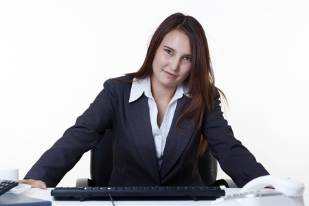 young looking woman at her desk looking at the camera Stock Photo - 14431816