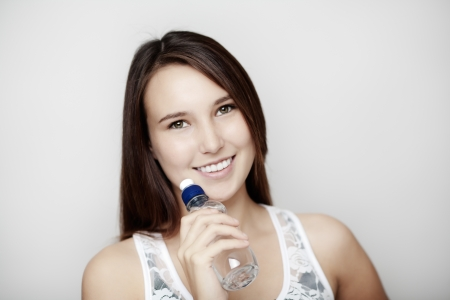 young girl keeping hydrated with a bottle of water Stock Photo - 14477698