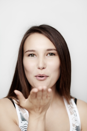 young woman blowing you a kiss Stock Photo - 14477695