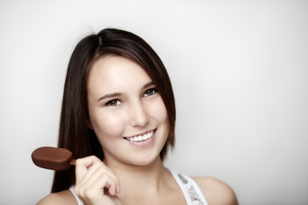 young woman eating a small ice cream Stock Photo - 14477704