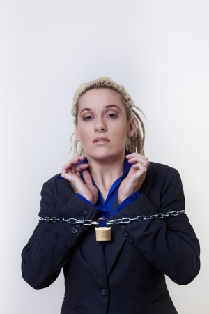 Business person with dreadlocks hair with a chain and padlock around her photo