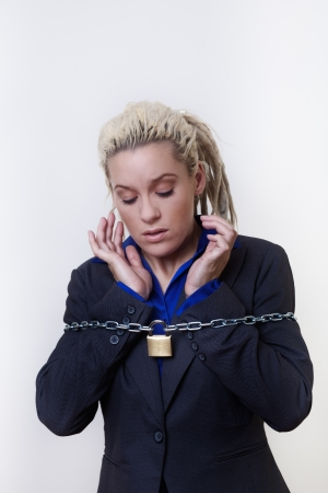 Business person with dreadlocks hair with a chain and padlock around her Stock Photo - 14696837