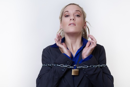 Business person with dreadlocks hair with a chain and padlock around her Stock Photo - 14696835