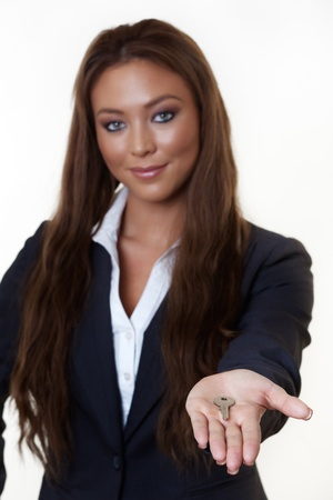 attractive woman wearing a suit holding a key photo