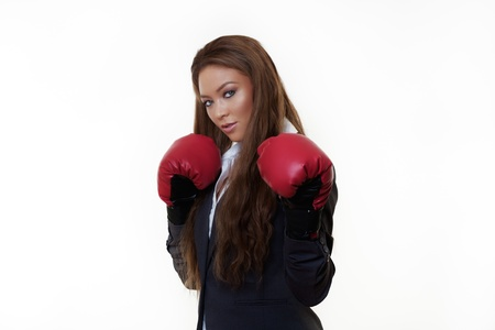 good looking woman in a suit wearing boxing gloves photo