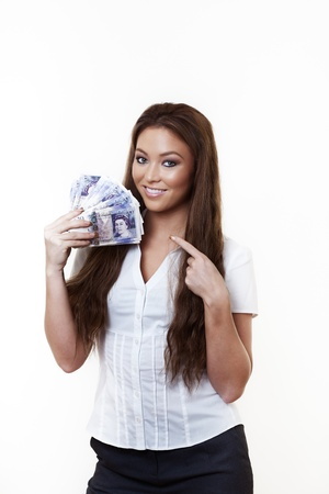 young attractive woman holding a hand full of english back notes photo
