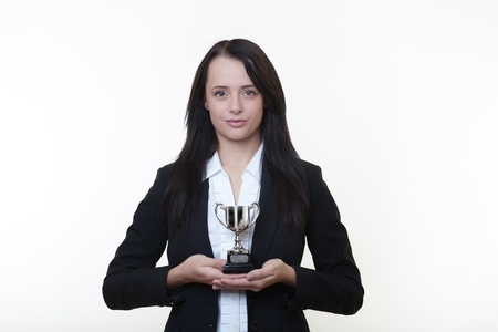 woman holding a small trophy in her hands Stock Photo - 14980883