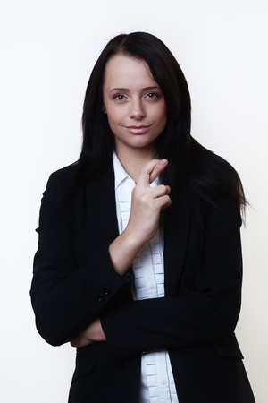 big deal: business woman with her finger crossed hoping the big deal she put together come off Stock Photo
