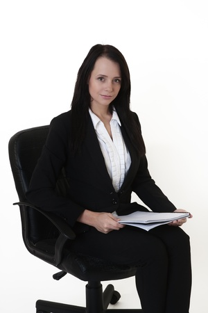 woman sitting down at work in a chair photo