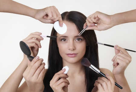 faster: woman doing make up with many hands and arms helping her get the job done faster