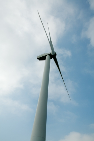 windpower: shots of single windmill for renewable energy production in england
