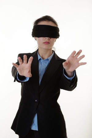 woman with a blind fold on so she can not see where she is going photo
