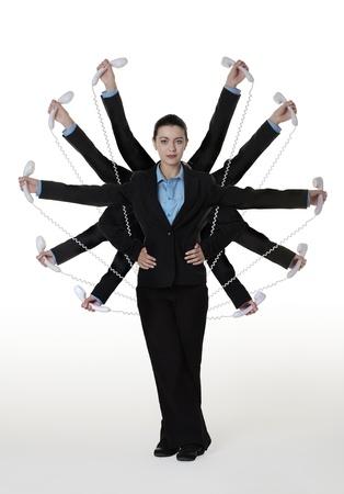 secretaries: mujer con muchos brazos que sostienen tel�fono Foto de archivo