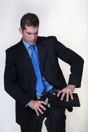 destroying: breaking a keyboard at work he must be having a bad day
