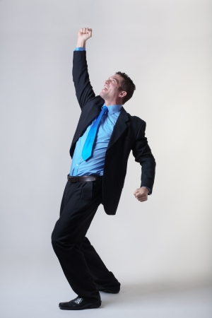 hooray: overjoyed business man expring his happiness