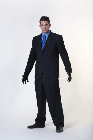hard looking man wearing gloves not someone to be trifled with Stock Photo - 15708155