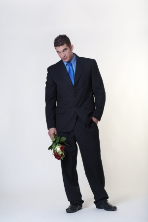 business man trying to give someone flowers Stock Photo - 15708137