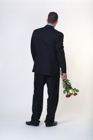 jilted: business man trying to give someone flowers