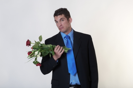 business man trying to give someone flowers Stock Photo - 15708030
