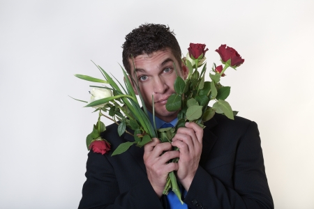 business man trying to give someone flowers Stock Photo - 15708220