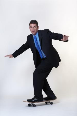 business man riding a  skateboards photo