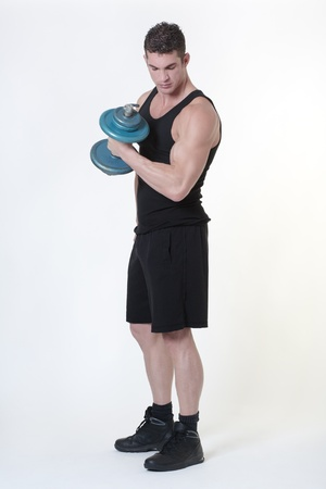 good looking man who works out each day and has a fit body lifting weights photo