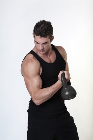 male bodybuilding doing a work out  lifting kettlebell Stock Photo - 15811537