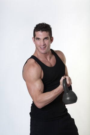 male bodybuilding doing a work out  lifting kettlebell Stock Photo - 15811558