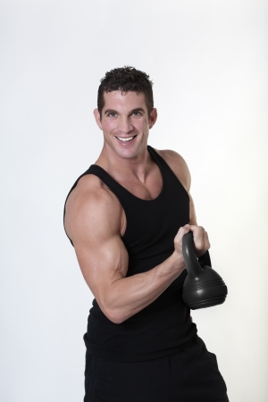 male bodybuilding doing a work out  lifting kettlebell Stock Photo