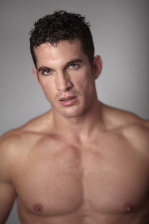 naked male body: close up portrait of a good looking man with his shirt of looking at camera Stock Photo