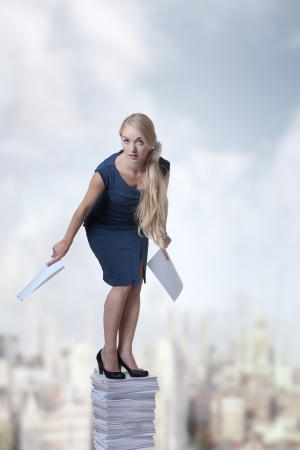 woman standing on a large pile of paper Stock Photo - 16084923