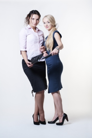 two woman holding a broken keyboard  Stock Photo - 16466740