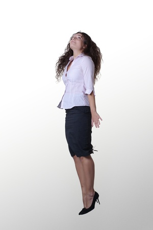 young woman flying in the air as if she has just taken off photo