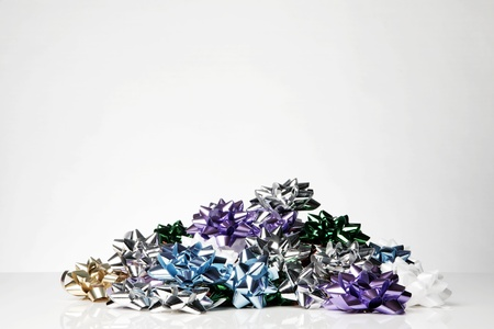 many pre made gift bows in a pile shot in a studio photo
