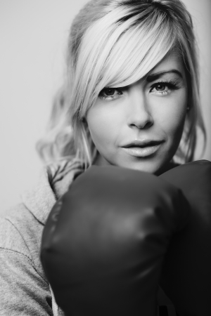 sexy woman wearing boxing gloves looking at camera photo