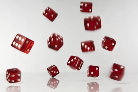 tumbling: lots of dice fulling and rolling shot in the studio on  white background