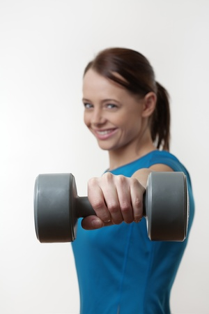 attractive woman doing a workout routine with a  dumbbell weights Stock Photo - 17079825